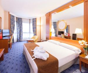 En eller flere senger på et rom på Hotel los Bracos by Silken