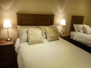 A bed or beds in a room at Hillview Self Catering