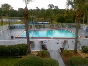 A view of the pool at Days Inn by Wyndham Daytona Beach Speedway or nearby