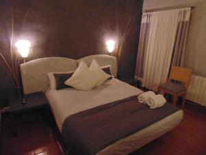 A bed or beds in a room at Rural Arco Iris Cuenca