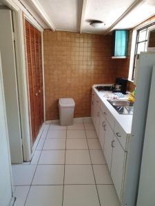 A cozinha ou cozinha compacta de Piscadera Bay Resort 52