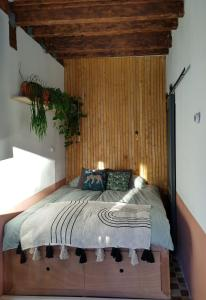 "A bed or beds in a room at Tiny House B&B ""Mañana"""