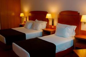 Ein Bett oder Betten in einem Zimmer der Unterkunft Hotel Regua Douro