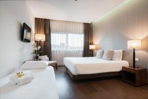 Cama o camas de una habitación en Eurostars Mar de Vigo