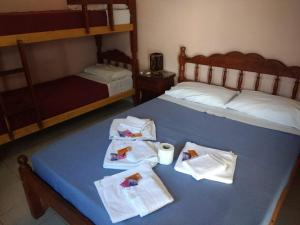 A bed or beds in a room at Hostal Portal del Valle