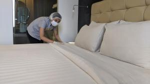 A bed or beds in a room at Liberty Hotel Thamrin Jakarta