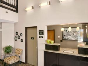 The lobby or reception area at Super 8 by Wyndham Stafford/Springfield Area