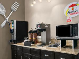 A television and/or entertainment center at Super 8 by Wyndham Stafford/Springfield Area