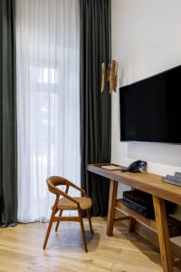 A television and/or entertainment center at Moss Boutique Hotel