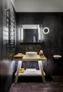 A bathroom at Moss Boutique Hotel