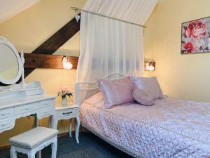 Кровать или кровати в номере Jaunmoku Palace Hotel