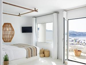A bed or beds in a room at Rocabella Mykonos Hotel
