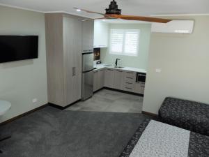 A kitchen or kitchenette at Barooga River Gums Motor Inn