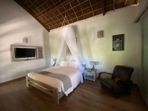 A bed or beds in a room at Sailing Club Resort Mui Ne