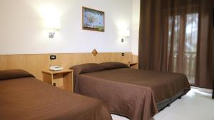 Letto o letti in una camera di Hotel Meranda