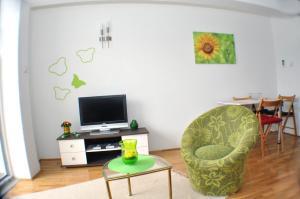 Телевизор и/или развлекательный центр в Belvedere Apartments