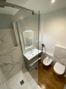 A bathroom at Artua'&Solferino-Mezza Pensione-Parcheggio