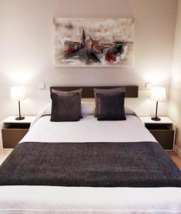 Cama o camas de una habitación en Cervantes Apartamentos