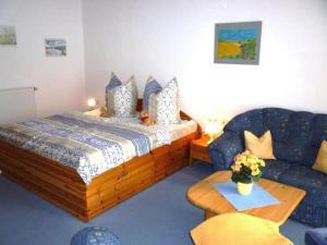 Ein Bett oder Betten in einem Zimmer der Unterkunft Hafenidylle Orth auf Fehmarn