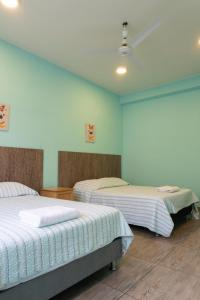 A bed or beds in a room at Desert Nights Hostel