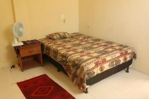 A bed or beds in a room at Casa Kukulcan