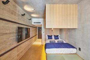 サクラクロスホテル新宿東アネックスにあるベッド