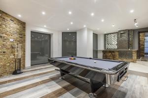 A pool table at Eltham Chateau Sleeps 24