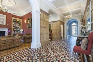 A seating area at Eltham Chateau Sleeps 24
