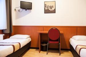 Een bed of bedden in een kamer bij Hotel Continental Amsterdam