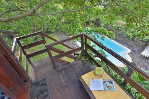 A view of the pool at Tree Lodge Mauritius or nearby
