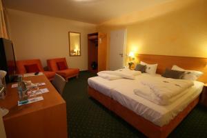 Ein Bett oder Betten in einem Zimmer der Unterkunft Berggasthof Hotel Igelwirt