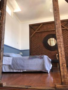 Cama o camas de una habitación en Casa Nomade Hotel Boutique