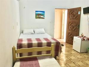 A bed or beds in a room at Aquarius de Iracema