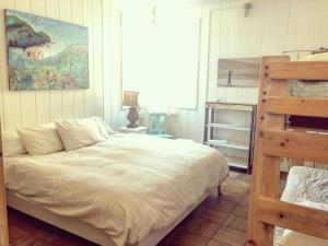 A bed or beds in a room at HI Point Reyes Hostel