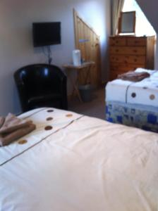 A bed or beds in a room at Tigh An Eilean