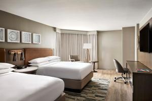 A bed or beds in a room at San Antonio Marriott Rivercenter