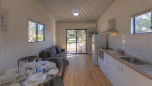 A kitchen or kitchenette at Killarney View Cabins and Caravan Park