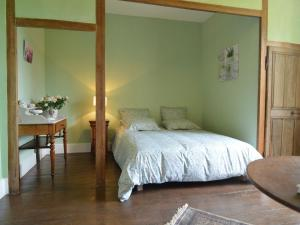 A bed or beds in a room at Lovely Country House with Pond in Champvert