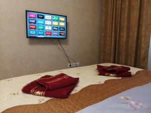 A television and/or entertainment centre at Sokol Apart-Hotel
