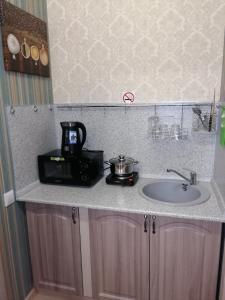A kitchen or kitchenette at Sokol Apart-Hotel