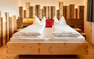 Letto o letti in una camera di Schweiggerhof