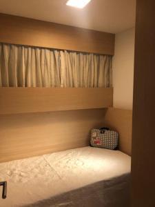 A bed or beds in a room at Apartamento na Beira-Mar Fortaleza