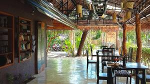 A restaurant or other place to eat at Herbs Guest House - Adults Only