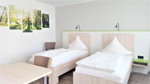 Ein Bett oder Betten in einem Zimmer der Unterkunft Motel Espenhof