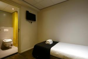Een bed of bedden in een kamer bij City Hotel Amsterdam
