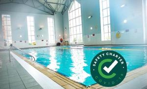 The swimming pool at or near Maldron Hotel & Leisure Centre, Oranmore Galway