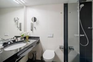Ванная комната в Best Western Plus Plaza Hotel Darmstadt