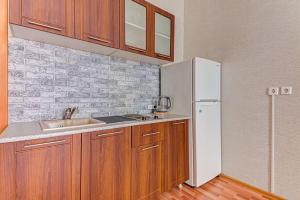 Кухня или мини-кухня в Apartment Hanaka Jubileinyi 78