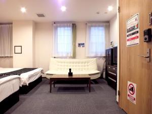 ホテル&コンドミニアム エアーベストにあるベッド