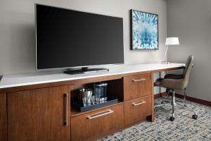 A television and/or entertainment center at Hilton Boston Logan Airport